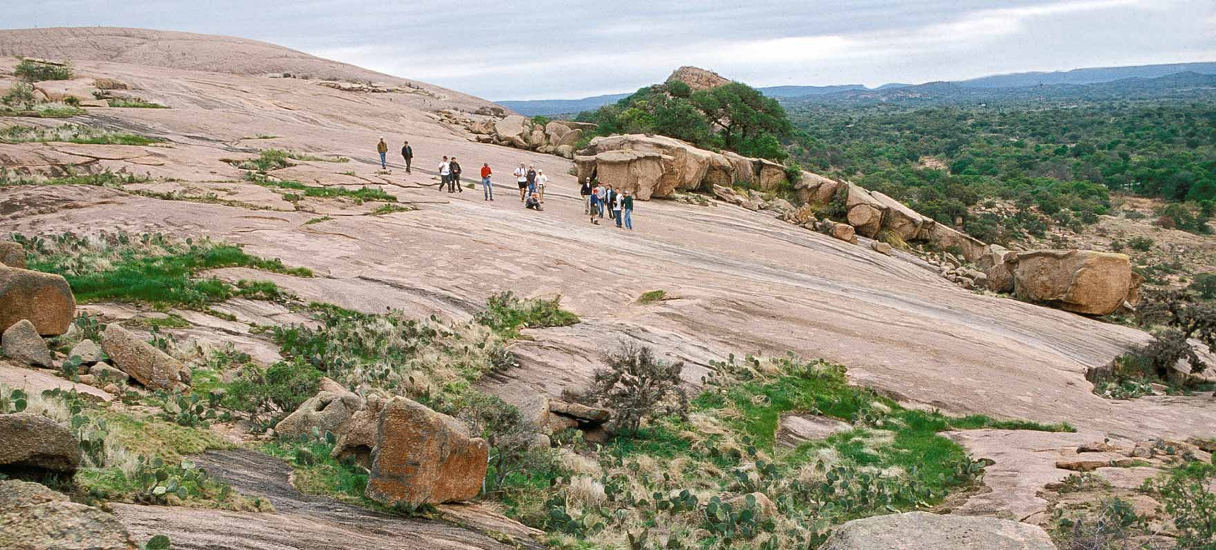enchanted rock Near fredericksburg, texas, enchanted rock is only about two hours from both austin and san antonio so it is a great place to get out of the city to enjoy the outdoors.